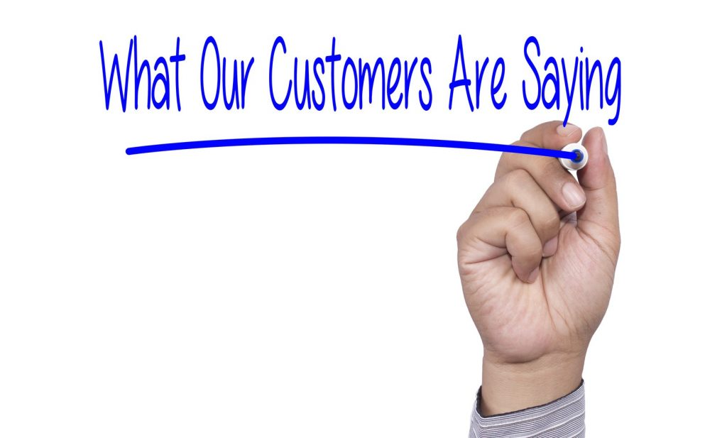 Business concept Hand writing What Our Customers Are Saying on v