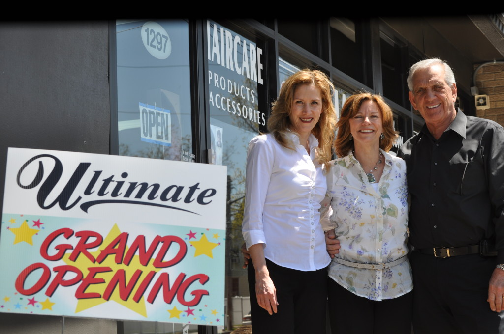 Brenda Mazza, left, and her partners, Robin and Joe Labita, celebrate the grand opening of their joint ventures, Ultimate Hair Techniques and Ultimate Hair & Retail Center, Sunnyside.