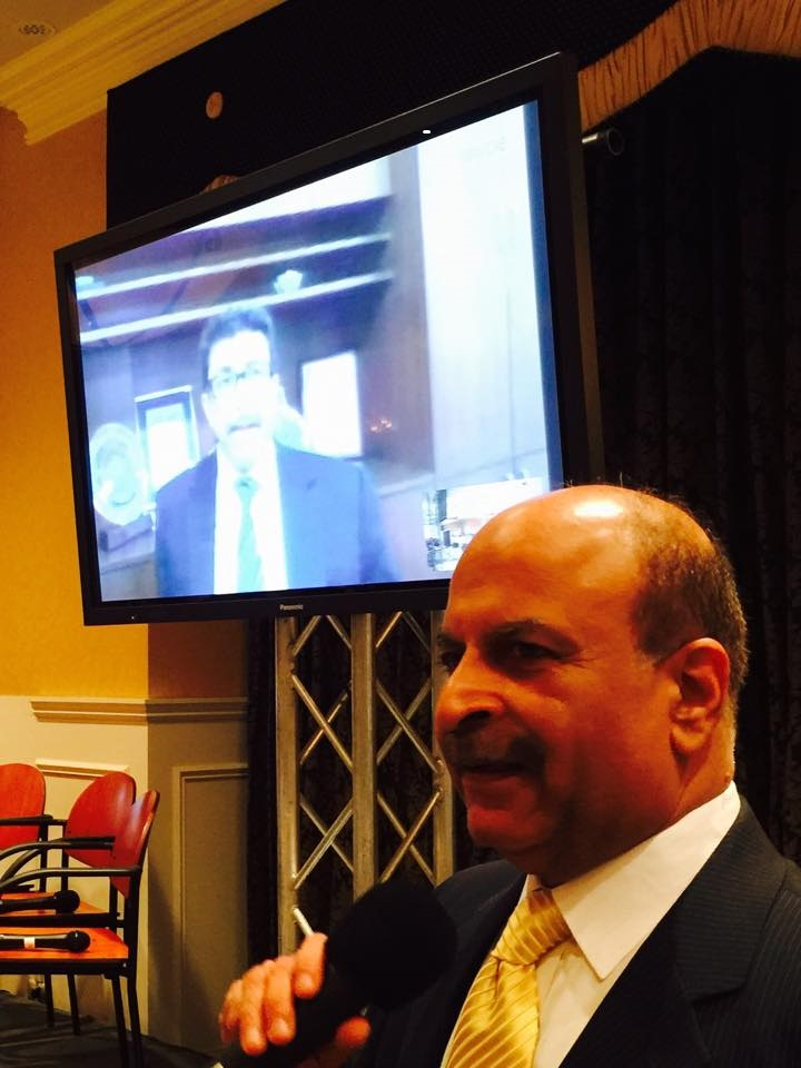 Farook Mahmood of the Silverline Group in India, seen in a live digital feed, discusses the navigation of foreign markets with Raj Rajpal of Wells Fargo Home Mortgage during SIBOR's 2015 Global Real Estate Summit on Staten Island. (Photo by Relevant Public Relations LLC)